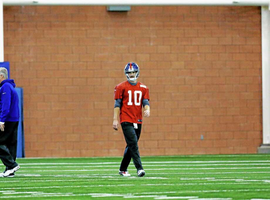 New York Giants quarterback Eli Manning walks on the practice field Wednesday in East Rutherford, N.J. Photo: Mel Evans — The Associated Press  / AP