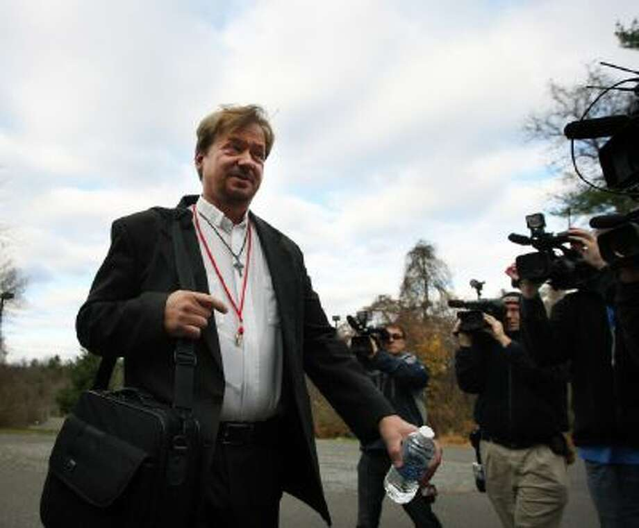The Rev. Frank Schaefer, right, of Lebanon Pa., before facing his sentencing at Camp Innabah, a United Methodist retreat, in Spring City Pa. Tuesday, Nov. 19, 2013.