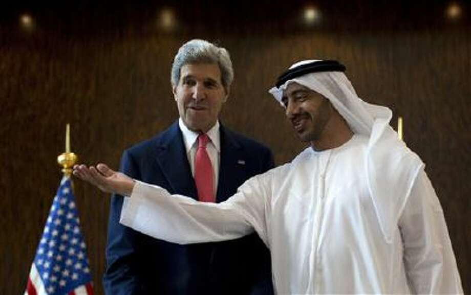 U.S. Secretary of State John Kerry, left, is welcomed Nov. 11 by United Arab Emirates Foreign Minister Abdullah bin Zayed Al-Nahyan at the foreign ministry in Abu Dhabi. Photo: AP / POOL Reuters