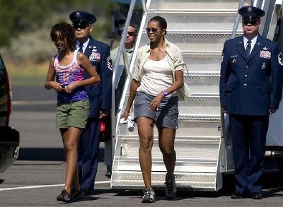 Michelle Obama walks off Air Force One in 2009 wearing shorts, which she later said she regretted. Photo: AP / AP