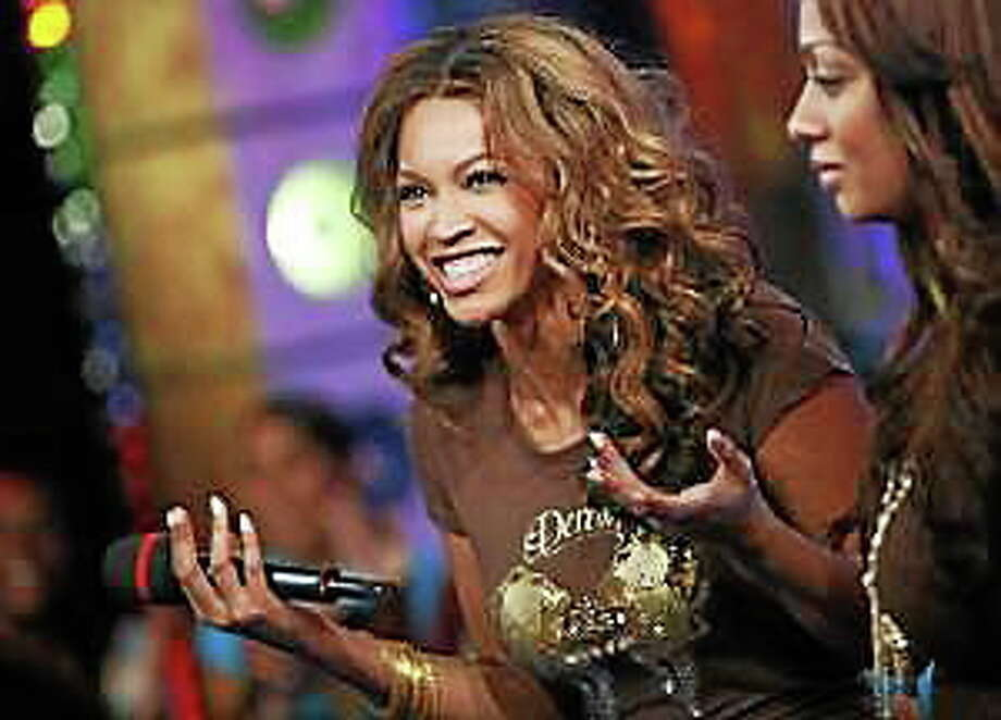 """Beyonce Knowles appears on MTV's """"Total Request Live"""" at the MTV Times Square Studios Thursday. Nov. 9, 2006. in New York. Photo: (Jason DeCrow — The Associated Press)"""