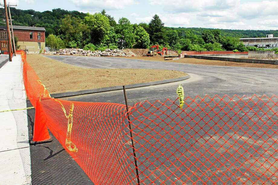 The parking lot on 100 Franklin St., seen here on Wednesday, July 30, is nearing completion. Photo: Esteban L. Hernandez — The Register Citizen