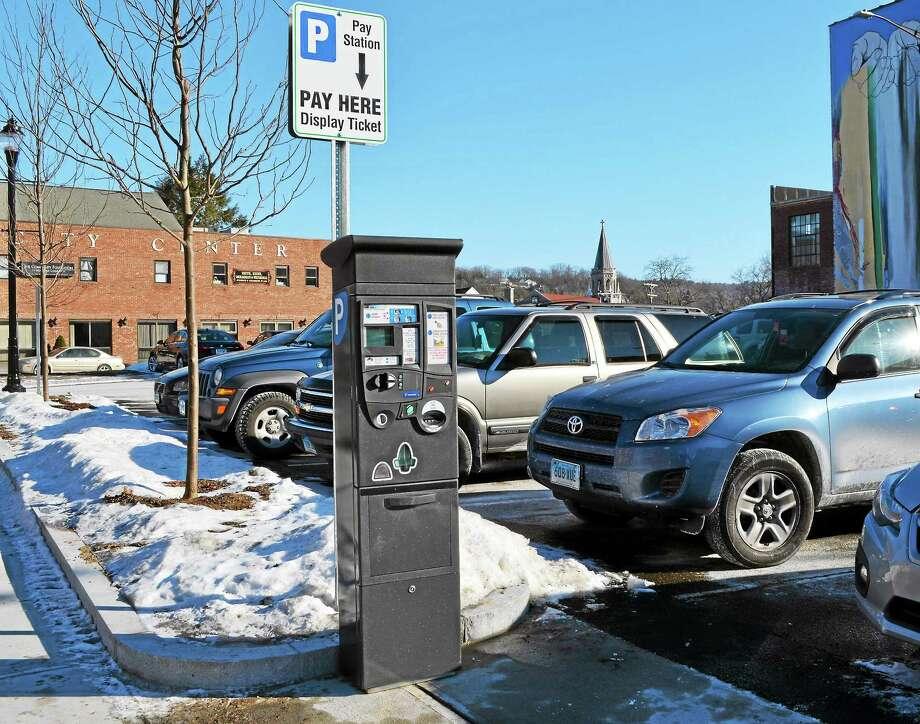Kate Hartman-Register Citizen ¬ A new parking meter kiosk was installed on City Hall Avenue in Torrington Thursday. Photo: Journal Register Co.