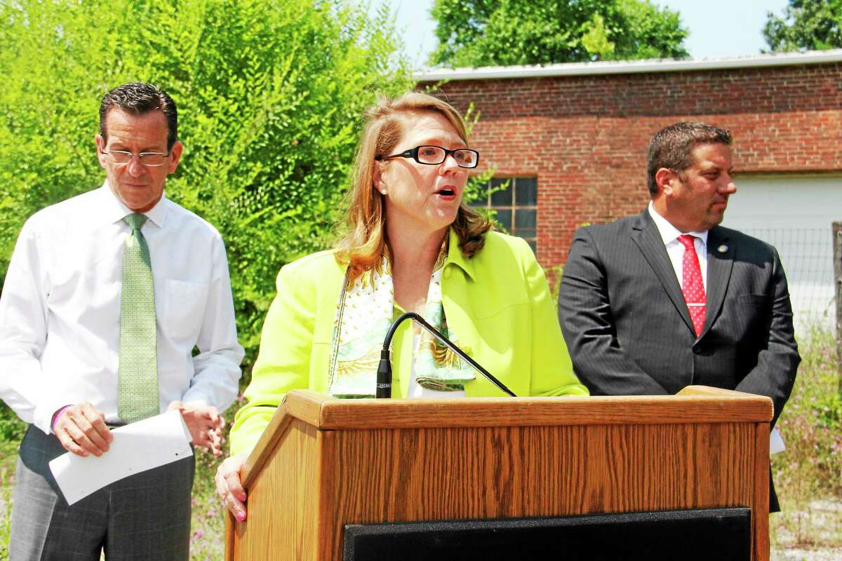 Winsted Mayor Marsha Sterling addresses the media and community members during a July 18 press conference announcing the town had received a $500,000 STEAP grant.