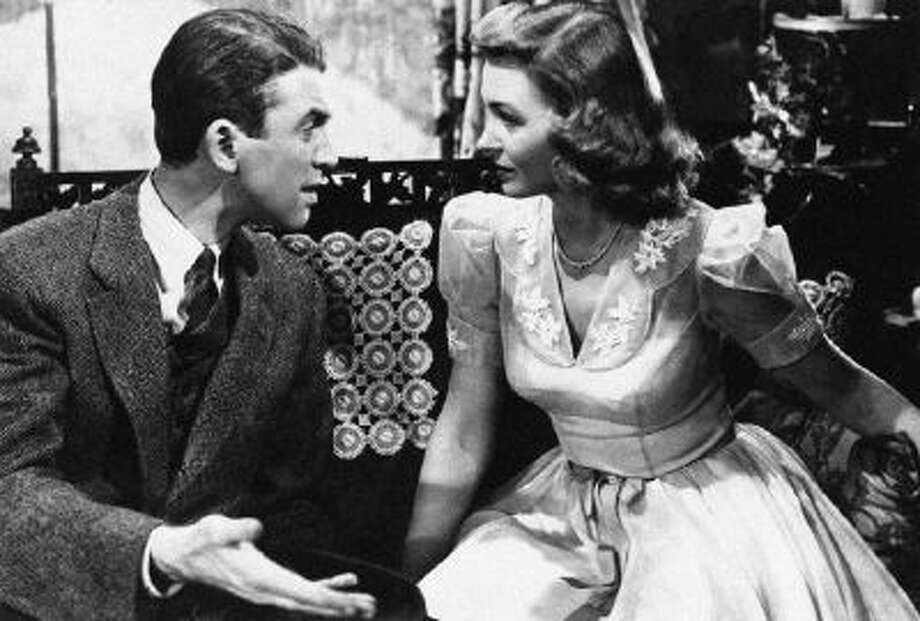 """Jimmy Stewart explains things to Donna Reed in """"It's a Wonderful Life"""" 1946."""