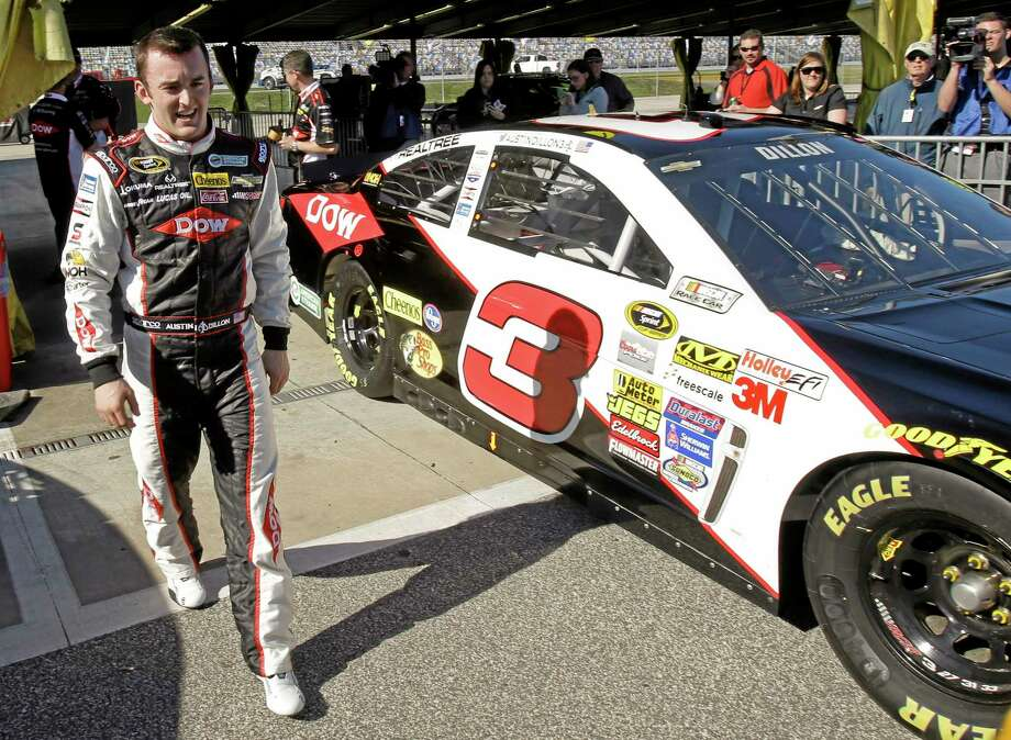 Austin Dillion walks by his car in the garage area after he won the pole position during qualifying for the Daytona 500 Sunday. Photo: John Raoux — The Associated Press  / AP