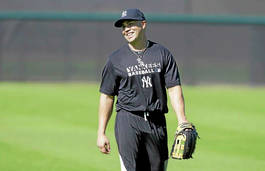 Yankees outfielder Carlos Beltran walks in the outfield during practice Monday in Tampa, Fla. Photo: Charlie Neirbergall — The Associated Press  / AP