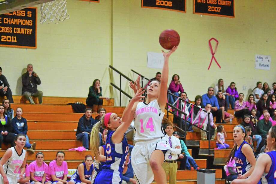Thomaston's Morgan Sanson lays in two of her 16 points over Nonnewaug's Courtney Carlson in the Golden Bears 54-36 win over the Chiefs. Photo: Pete Paguaga — Register Citizen