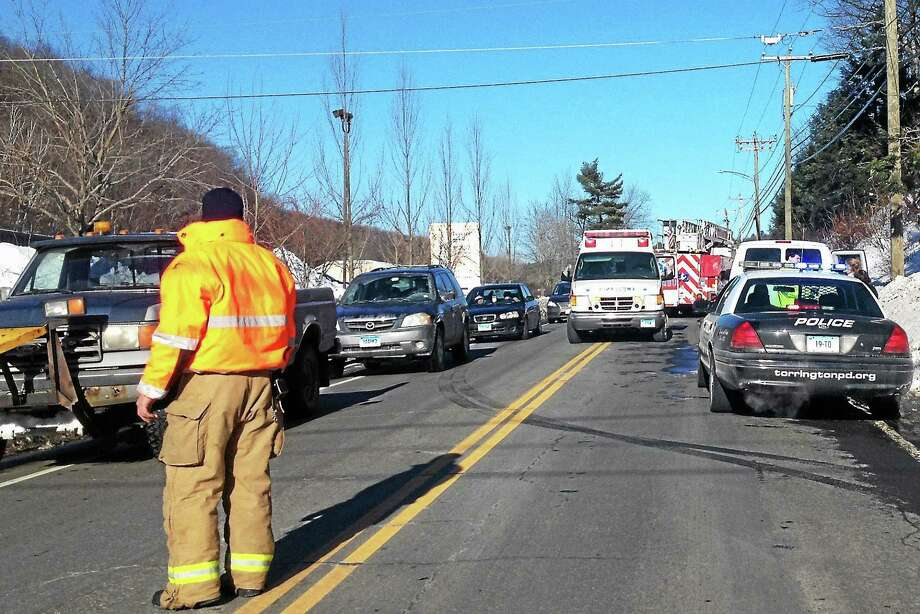 Emergency responders helped to direct traffic around an accident on Winsted Road Monday. Photo: Kate Hartman—Register Citizen