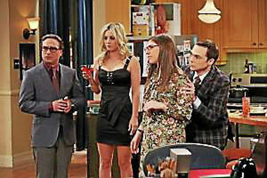 """Howard struggles with whether or not he should open a letter from his father, and Leonard (Johnny Galecki, left) and Penny (Kaley Cuoco, left center) throw a cocktail party on """"The Big Bang Theory."""" Photo: (Michael Yarish — Warner Bros.)"""