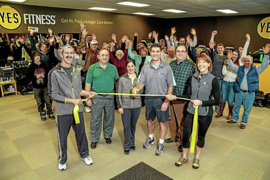 Fitness Coach Reid Matusek, Burlington Chamber of Commerce president Michael Scheidel, Fitness Coach Michelle Savino, Y.E.S. Fitness Owner and Founder Chris Borda, First Selectman Ted Shafer and Fitness Coach Brenda Nye cut the ribbon at Y.E.S. Fitness's open house on Feb. 15. Photo: Submitted Photo