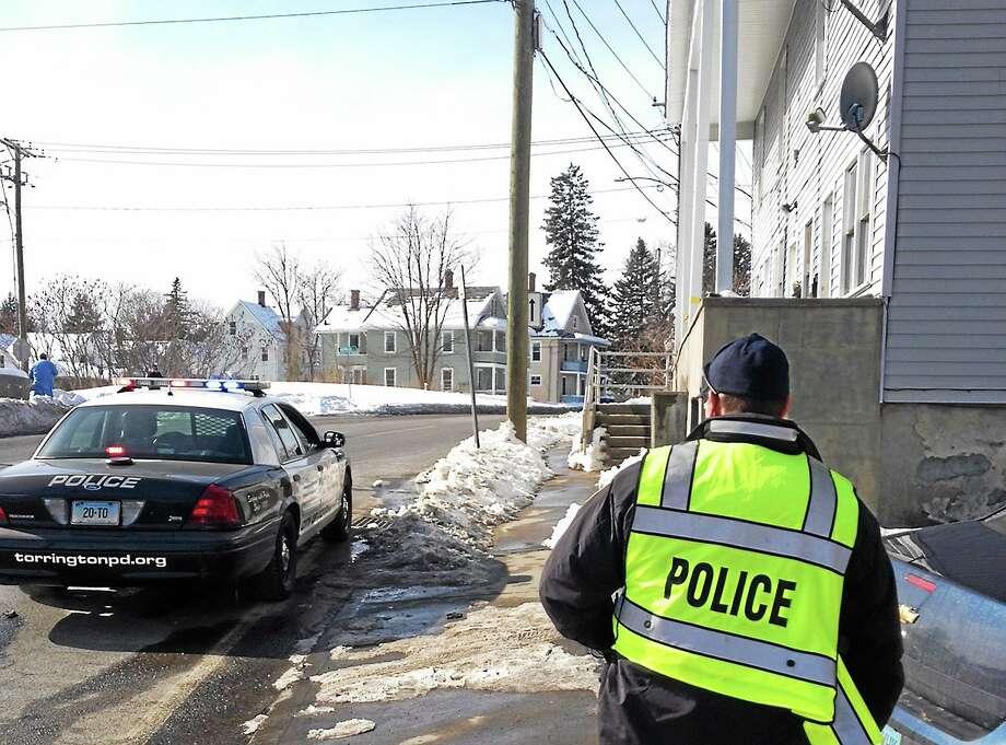 Torrington police investigate the scene of a fatal stabbing on North Elm Street Feb. 9. Photo: Isaac Avilucea—The Register Citizen