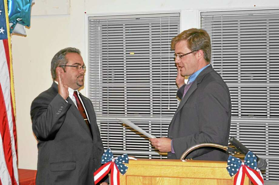 State Sen. Jason Welch, R-Bristol, left, swears in First Selectman Michael Criss at a Town Hall ceremony Monday night. Photo: Kate Hartman — Register Citizen