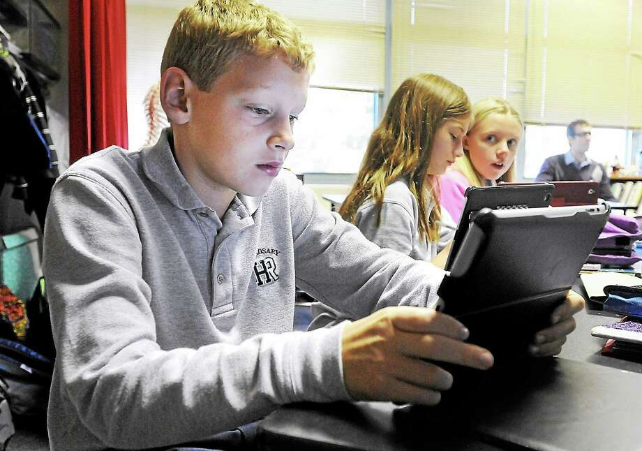 6th grade students at Holy Rosary School in Plymouth, Pa. use their iPads during a science class as part of the school's Project Launch Pad. Photo: File Photo — Times Herald