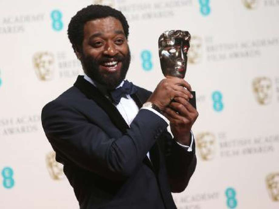 Chiwetel Ejiofor winner of best actor poses in the winners room at the EE British Academy Film Awards held at the Royal Opera House on Feb. 16, 2014 in London.