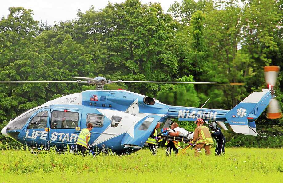 A Life Star helicopter transports a man to Hartford Hospital after a motorcycle accident on Route 4 Tuesday in Goshen. The man had a head injury, but authorities did not specify the severity of his condition. Photo: Esteban L. Hernandez — The Register Citizen