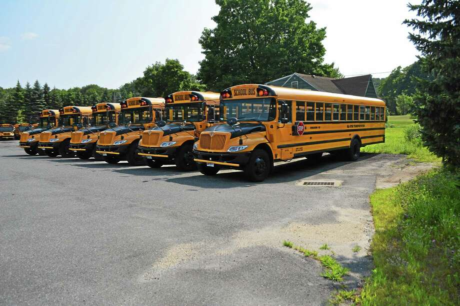 The current bus lot for the Burlington and Harwinton school buses, at Hank's Garage. Photo: Jenny Golfin — The Register Citizen