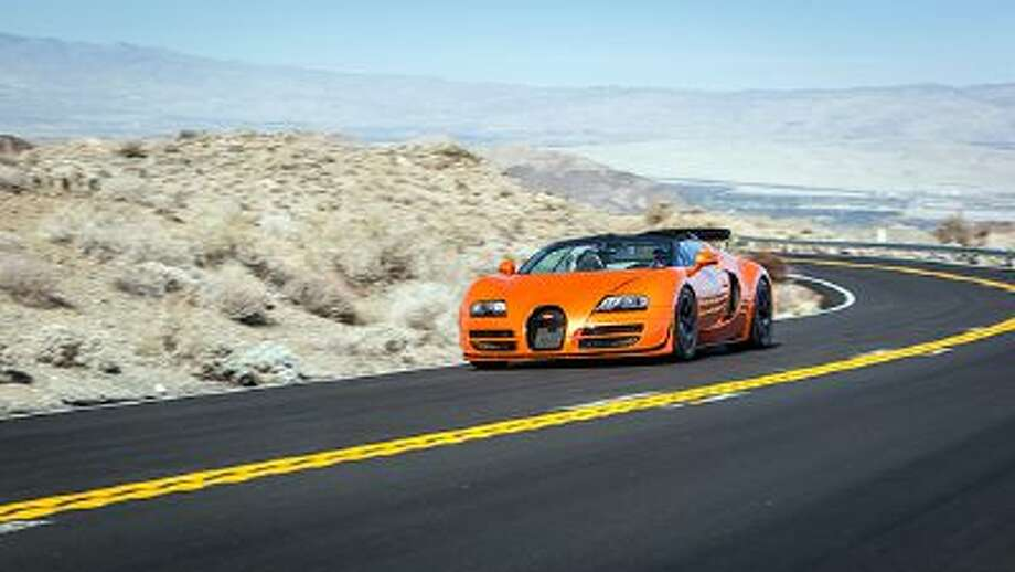 Volkswagen needs to unload some 62.5 million euros ($84.9 million) of Bugatti Veyron supercars. How? By putting together four regional events around the United States this year, offering test-drives of the 1,200-horsepower Vitesse convertible, both on open roads and a closed airport runway. Photo: BLOOMBERG NEWS / © 2014 Bugatti & Mo Satarzadeh. All Rights Reserved.