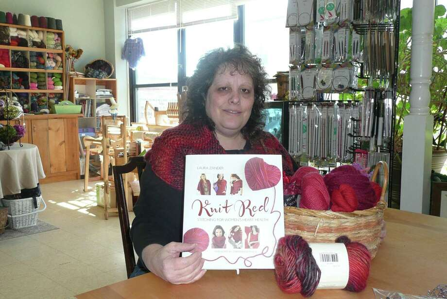 KATE HARTMAN/Register Citizen Ginger Balch, owner of In Sheep's Clothing in Torrington, organized Sunday's Go Red for Women, a benefit and educational event for women's heart health. Susan Saint James is the Master of Ceremonies.