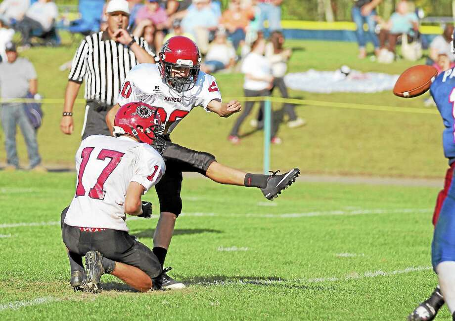 Torrington's kicker PJ Killmartin has been one of the most consistent offensive contributors for the Red Raiders this season, connecting on 26 extra points and two field goals. Photo: Marianne Killackey — Special To The Register Citizen  / 2013