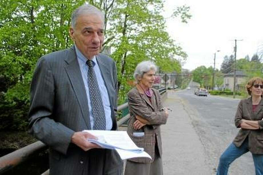 Register Citizen File Photo - Ralph Nader stands on the Holabird Avenue Bridge in Winsted in May 2013, which town officials say must be replaced.