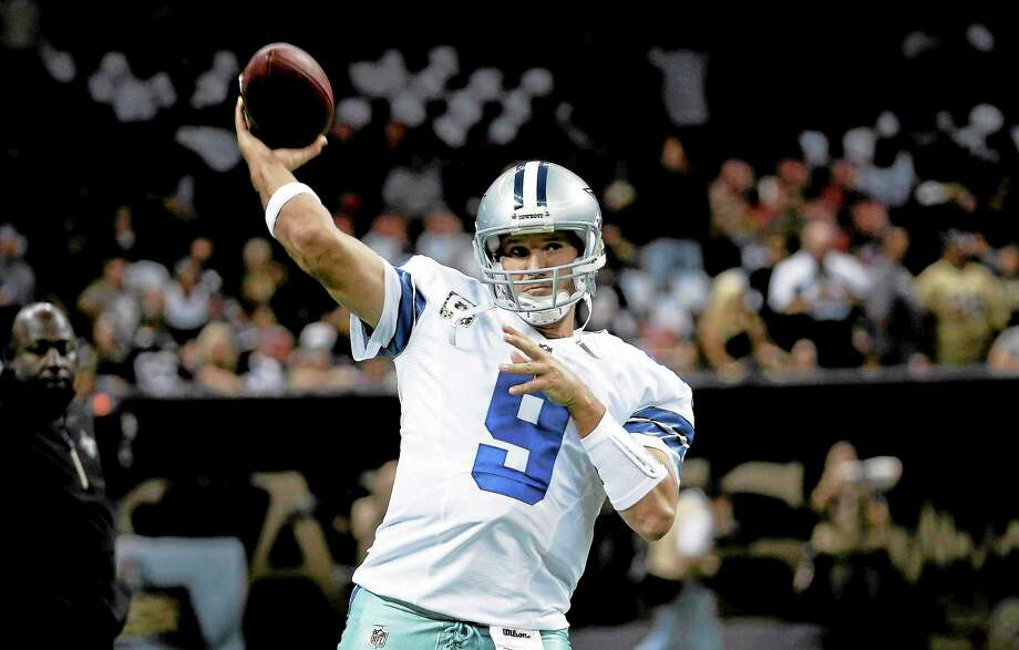 For the first time in five weeks the Giants will be facing a healthy starting quarterback when they host Tony Romo and the Cowboys on Sunday. Photo: Dave Martin — The Associated Press  / AP