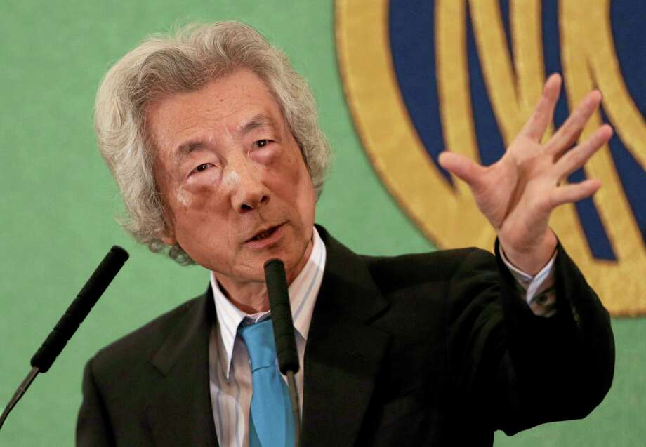 """Former Japanese Prime Minister Junichiro Koizumi speaks during a press conference at the Japan National Press Club in Tokyo Tuesday, Nov. 12, 2013. Koizumi said Tuesday that the current prime minister, Shinzo Abe, should use his public popularity to """"do the right thing."""" Koizumi said that with Japan's nuclear plants all offline for safety checks following the Fukushima disaster it would be easier to begin the phase-out soon. (AP Photo/Shizuo Kambayashi) Photo: AP / AP"""