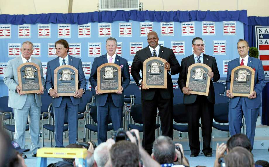 National Baseball Hall of Fame inductees, from left, Bobby Cox, Tony La Russa, Tom Glavine, Frank Thomas, Greg Maddux and Joe Torre hold their plaques after Sunday's induction ceremony in Cooperstown, N.Y. Photo: Mike Groll — The Associated Press  / AP