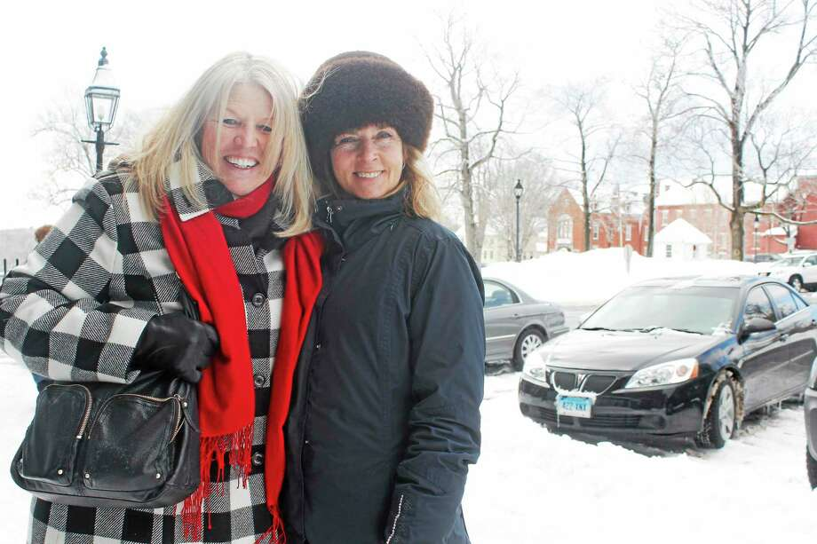 Locals Maureen Pratt(right) and Dale Parker(left) love the snow. Photo: Shako Liu-The Register Citizen