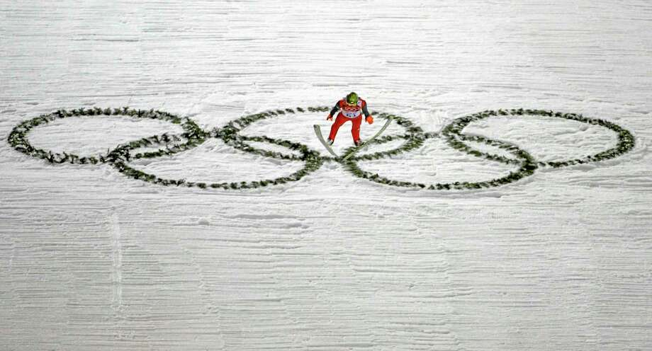 Poland's Kamil Stoch makes his trial jump during the ski jumping large hill qualification at the 2014 Winter Olympics, Friday, Feb. 14, 2014, in Krasnaya Polyana, Russia. (AP Photo/Gregorio Borgia) Photo: AP / AP