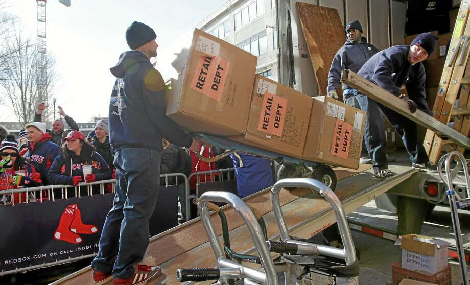Workers load boxes into the Boston Red Sox equipment truck in front of Fenway Park on Feb. 8. The truck took off for the Red Sox's spring training home in Fort Myers, Fla. Photo: Chitose Suzuki — The Boston Herald  / Boston Herald