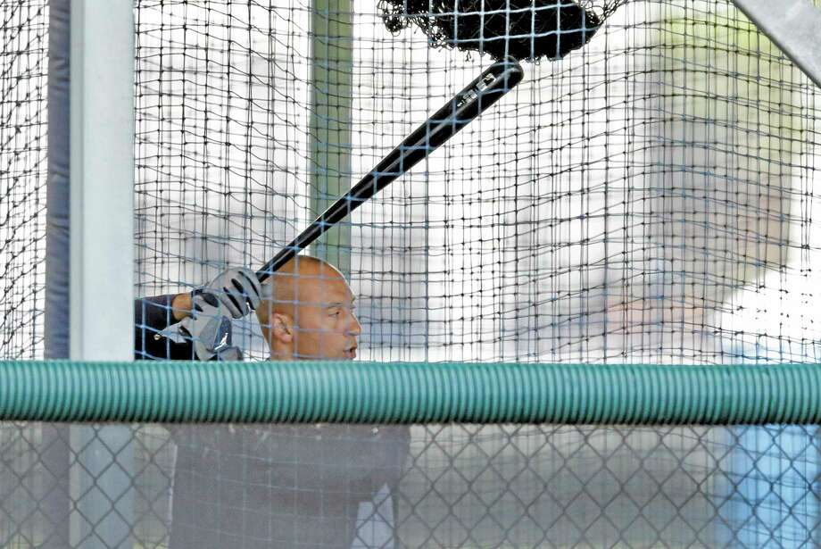New York Yankees shortstop Derek Jeter hits in a batting cage during a workout at the team's minor league facility on Thursday in Tampa, Fla. Photo: Chris O'Meara — The Associated Press  / AP