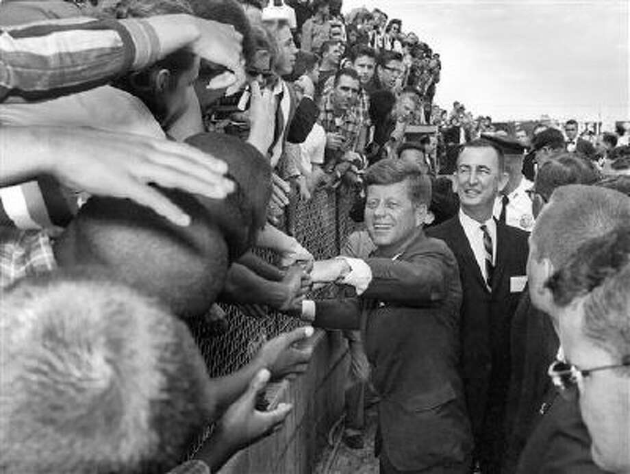 President John F. Kennedy shakes hands of spectators in Tampa, Fla., on Nov. 18, 1963. President Kennedy was in Tampa to give a speech commemorating the 50th anniversary of the first scheduled passenger airplane flight. Photo: AP / Tony Zappone