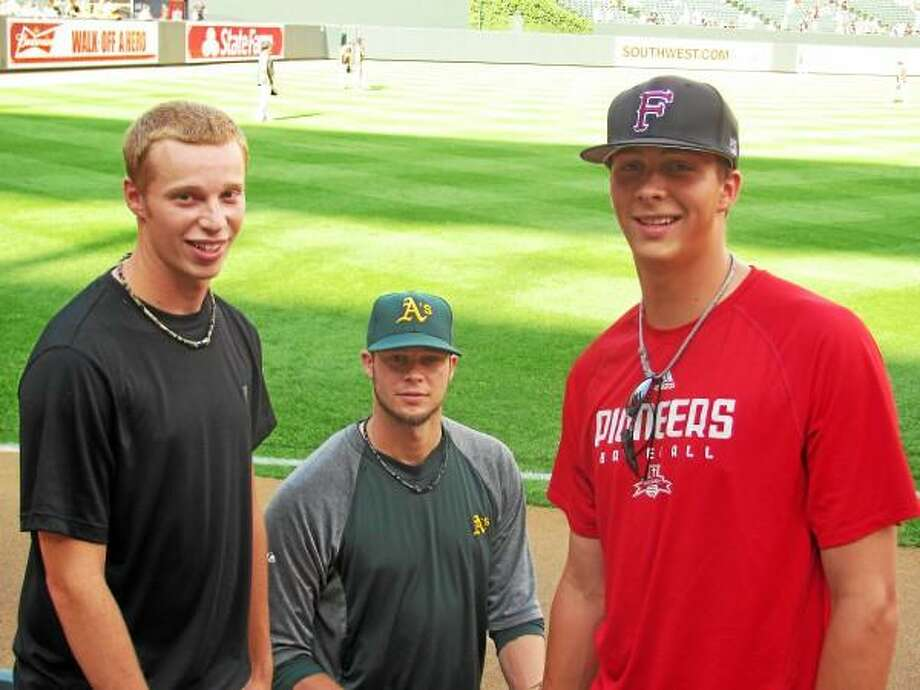 Submitted Photo  Miles (right), Troy (left) with Evan while him and the A's visited the Yankees at Yankee Stadium.