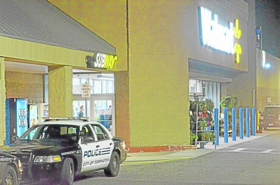 Police say that a bomb threat was called in to the Walmart in Torrington on Monday. Police cleared the shopping center for a few hours before clearing employees and shoppers to return around 8 p.m. John Berry - Register Citizen Photo: Journal Register Co.
