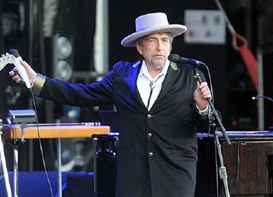 """This July 22, 2012 file photo shows U.S. singer-songwriter Bob Dylan performing on at """"Les Vieilles Charrues"""" Festival in Carhaix, western France. Photo: AP / AP"""