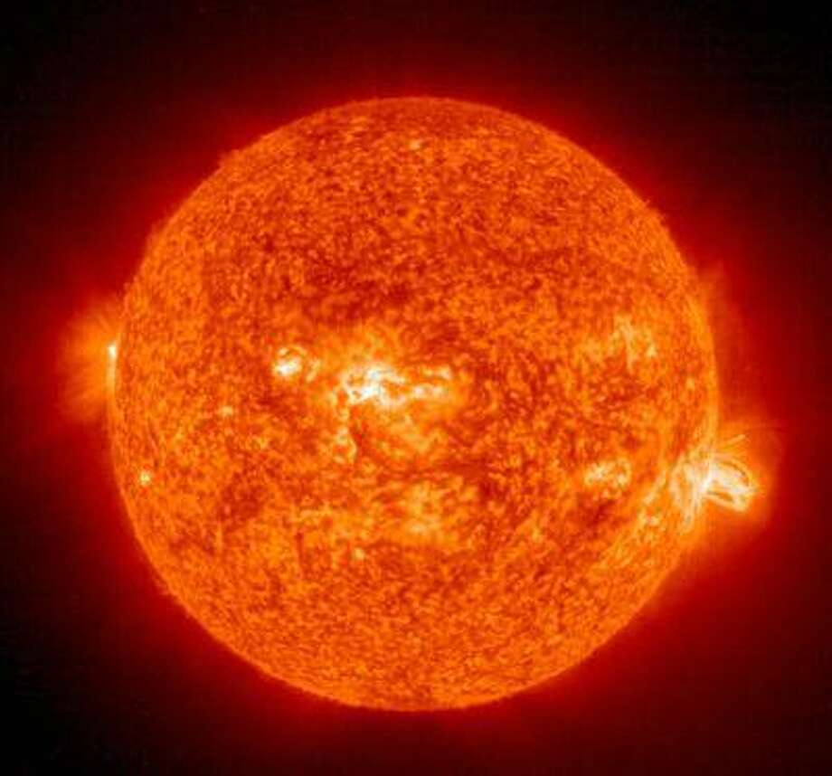 This 19 August, 2004 NASA Solar and Heliospheric Administration image shows a solar flare(R) erupting from giant sunspot 649. Photo: AFP/Getty Images / 2004 AFP