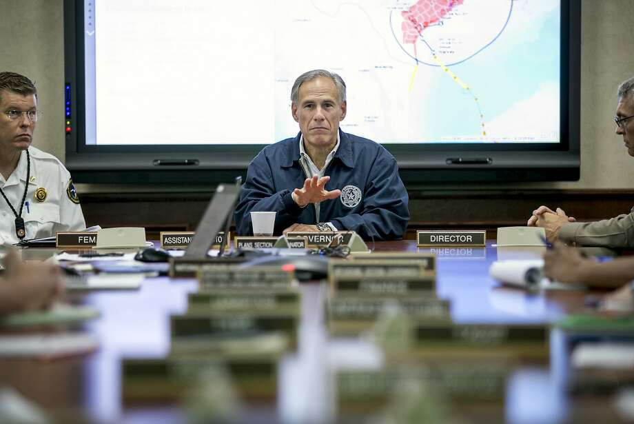 Gov. Greg Abbott attends a meeting with local, state and federal officials at the State Operations Center in Austin, Texas, on Friday Aug. 25, 2017, in preparation for Hurricane Harvey. (Jay Janner/Austin American-Statesman via AP) Photo: Jay Janner, Associated Press
