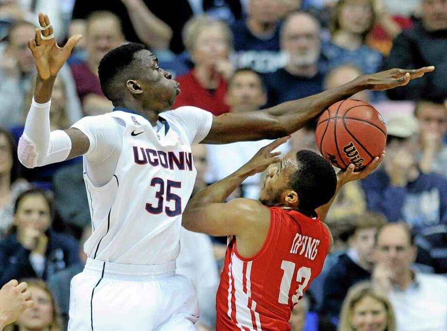 UConn's Amida Brimah attempts to block the shot of Boston University's D.J. Irving during Saturday's game in Storrs. Photo: Fred Beckham — The Associated Press  / FR153656 AP