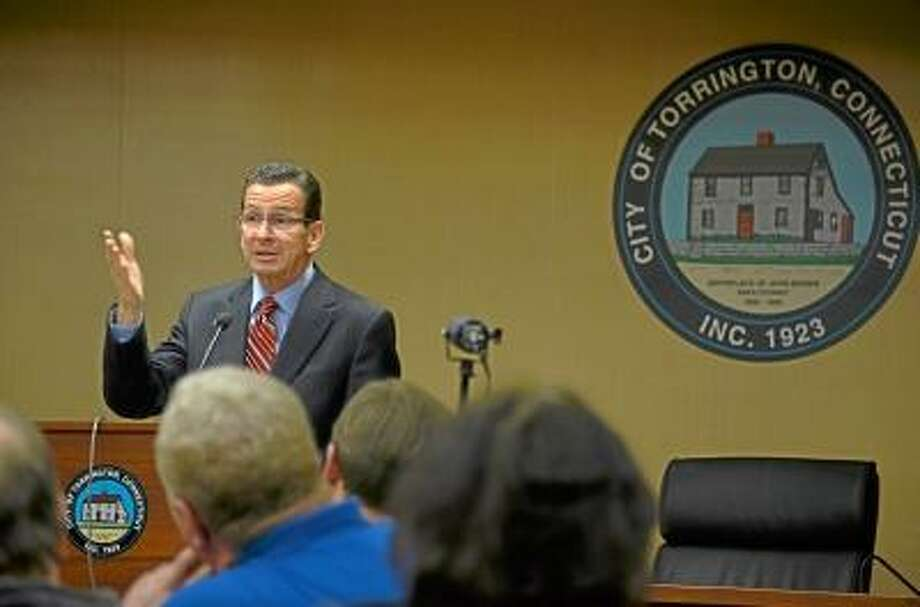 Tom Caprood / Register Citizen -- Gov. Dannel P. Malloy speaks to a small crowd during Wednesday during a town hall meeting at Torrington City Hall.