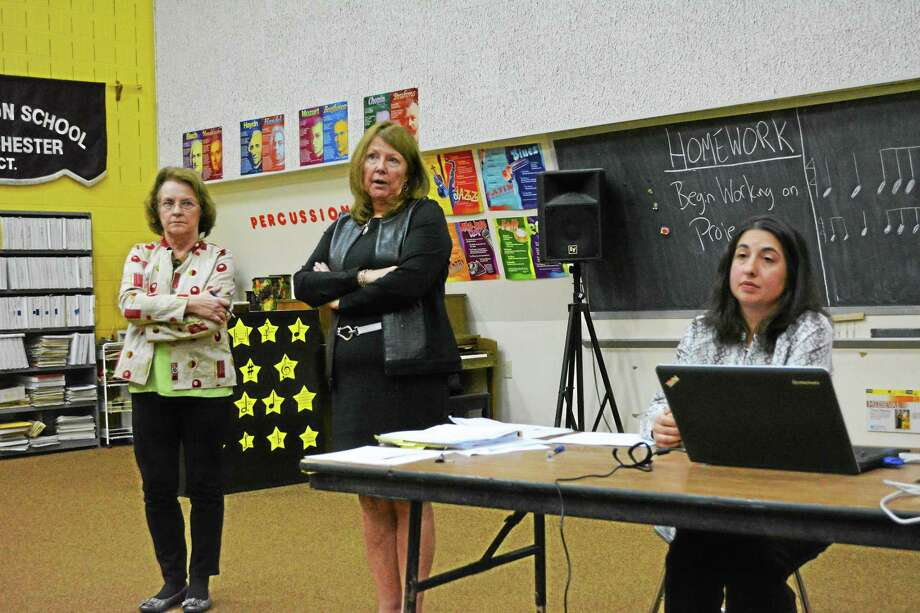From left: Board of Education chair Susan Hoffnagle and CREC representatives Margaret MacDonald and Nicole Natale take questions from BOE members in the crowd during a presentation Tuesday night. Photo: Ryan Flynn — The Register Citizen