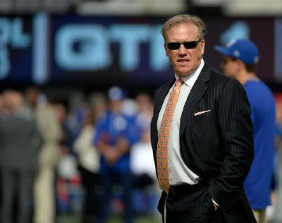Broncos executive VP of football operations John Elway is now also the team's general manager.