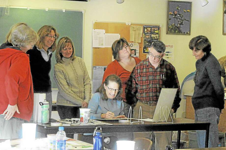 Betsy Rogers-Knox (seated) demonstrates a technique to a group learning to paint New England autumn scenery at White Memorial Conservation Center in Litchfield on Saturday.Laurie Gaboardi - Register Citizen Photo: Journal Register Co.