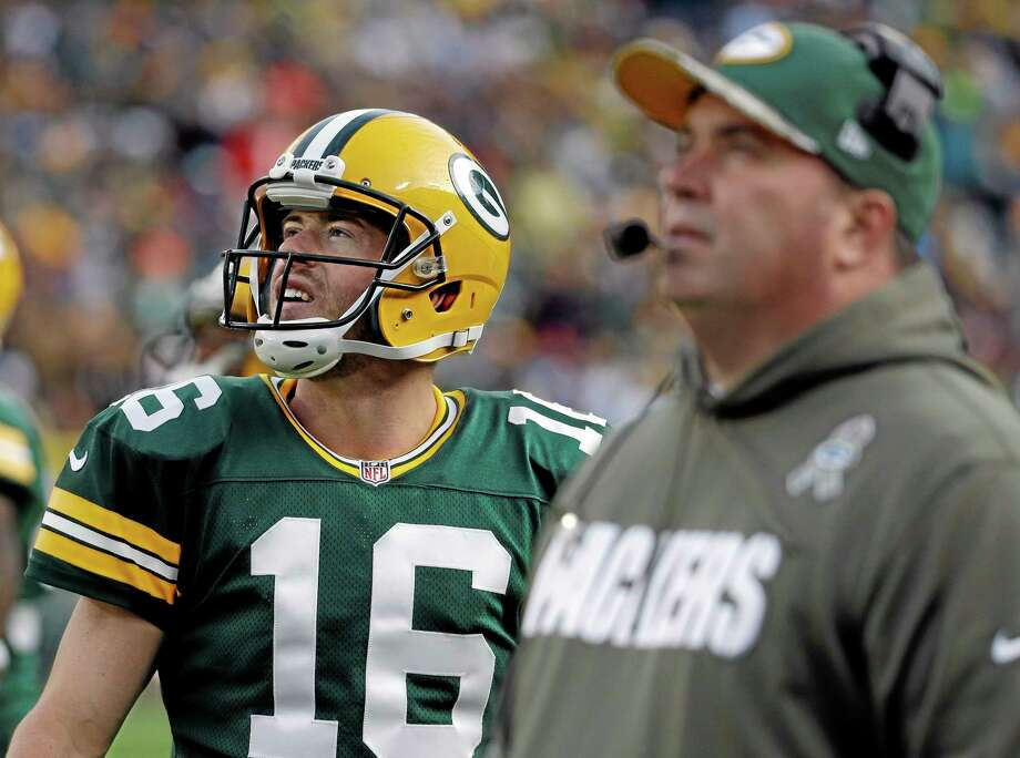 Packers head coach Mike McCarthy and quarterback Scott Tolzien look at a video board during their game against the Eagles last Sunday. Photo: Morry Gash — The Associated Press  / AP