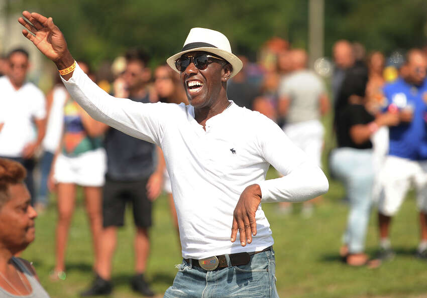 Mouricio Santos, of Bridgeport, dances to the music at the 5th Brazilian Day Festival at Seaside Park in Bridgeport, Conn. on Sunday, August 27, 2017. The event featured live bands, Zumba, and a variety of traditional fodd and drink.