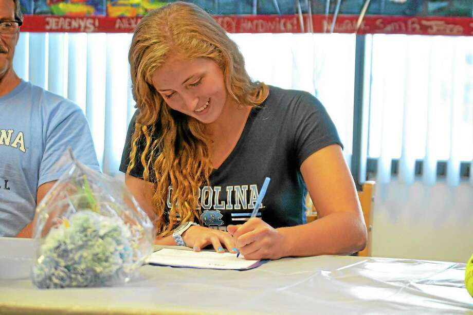 Torrington's Sydney Matzko signed her national letter of intent to play softball at the University of North Carolina on Friday in the library at Torrington high school in front of her parents, administrators, teammates and classmates. Photo: Pete Paguaga — Register Citizen