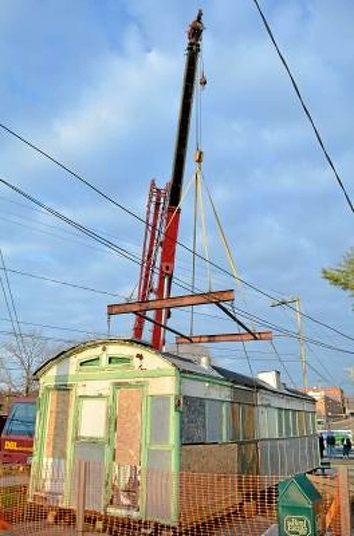 Skee's Diner was moved Sunday morning by the Torrington Historic Preservation Trust. The plan is to restore it while in storage and then move it to its new home. John Berry/Register Citizen.