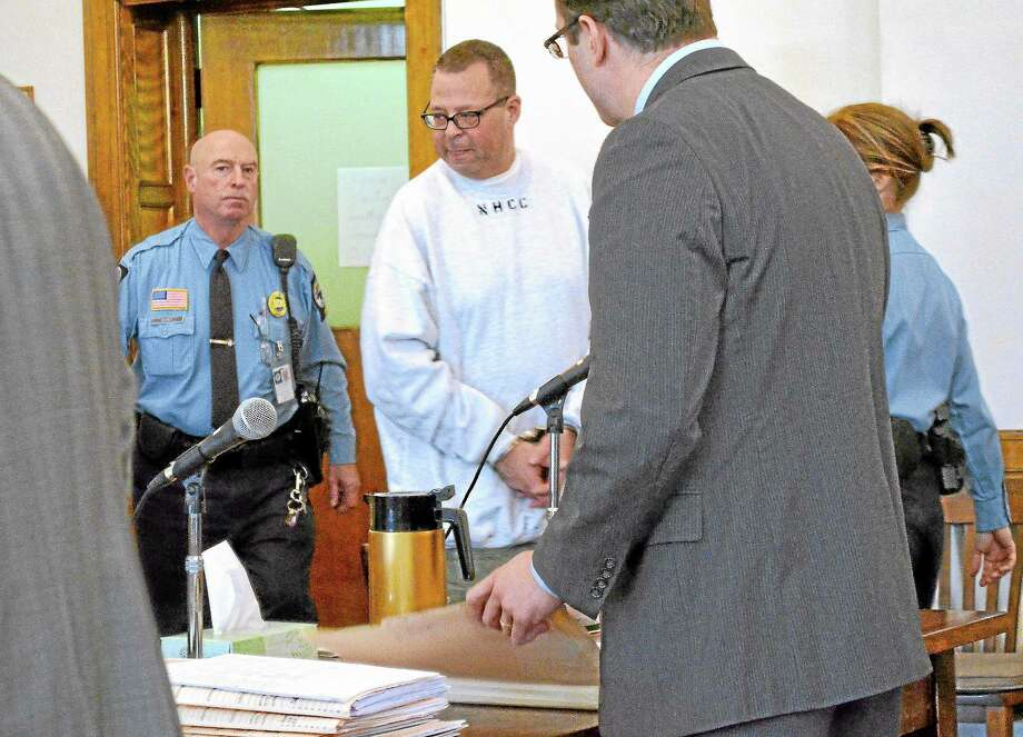 Henry Centrella walks into the court room in Litchfield to enter a not guilty plea. Centrella is accused of stealing nearly $2.5M from the city of Winsted while he was the finance director for more than 30 years. Photo: John Berry—Register Citizen