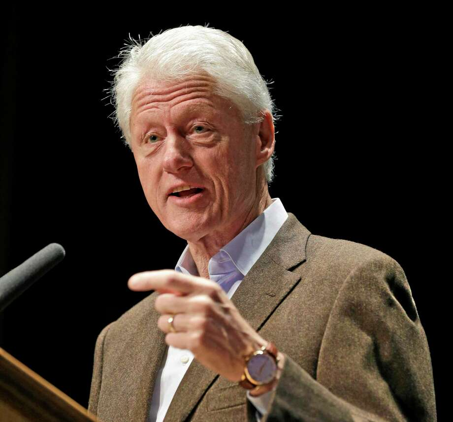 """FILE - President Bill Clinton has brought pressure on Obama to fix the administration's problem-plagued health care program, particularly to find a way to let people keep their health coverage, even if it means changing the law. Clinton says Obama should """"honor the commitment that the federal government made to those people and let them keep what they got.""""  (AP Photo/Steve Helber, File) Photo: AP / AP"""