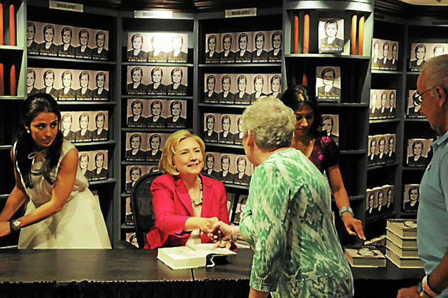 Hillary Clinton greets buyers lined up for signed copies of her new book ìHard Choicesî at R.J. Julia Booksellers in Madison. Photo: Mara Lavitt--New Haven Register
